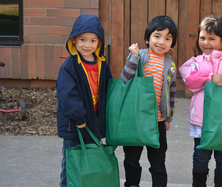 Kids with green book bags