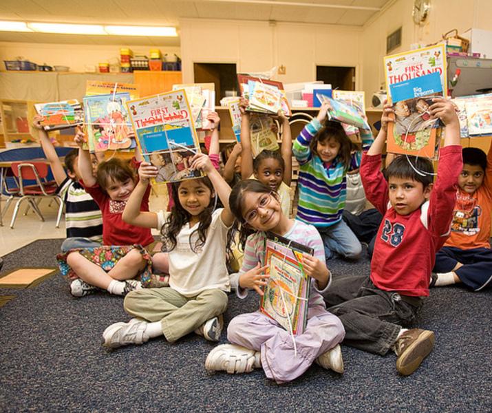 Kids showing books